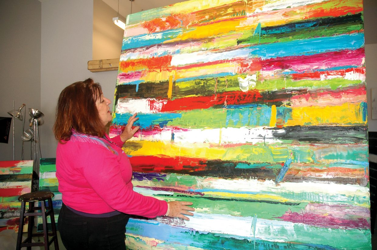 Monroe hodder explains the emotions behind one of her pieces of abstract art wednesday in her studio the local artists work will be on display at k saari