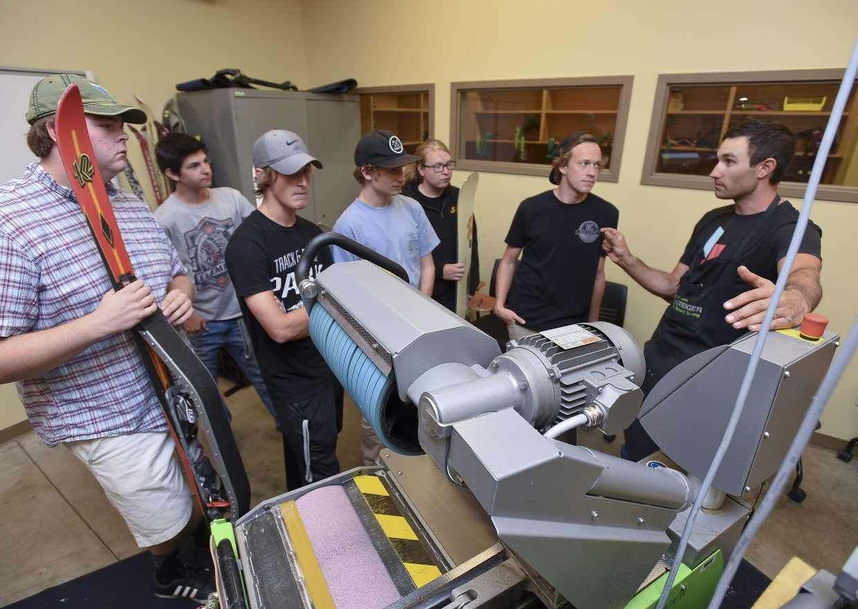 Instructor Alex Pond teaches students about ski tuning during a class at Colorado Mountain College.