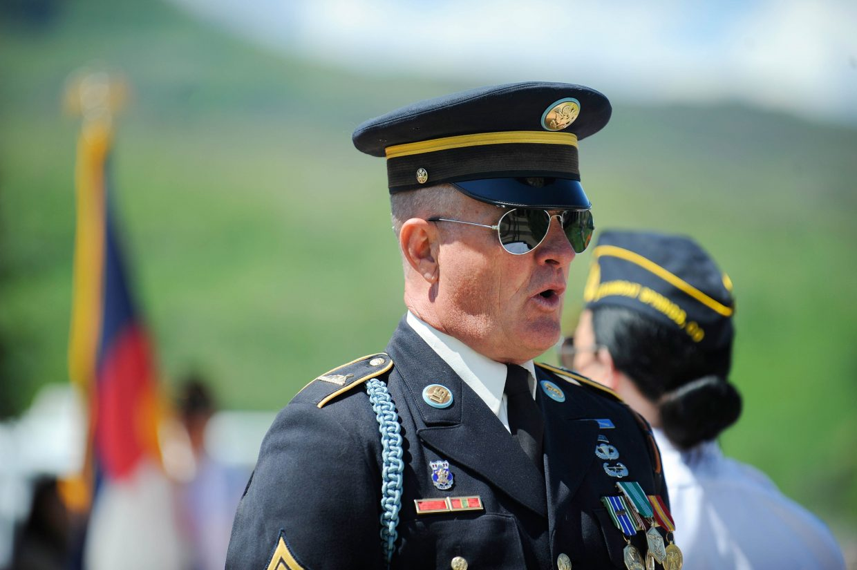 Sergeant-at-Arms Dennis Fisher speaks during Monday's Memorial Day ceremony at Steamboat Springs Cemetery.