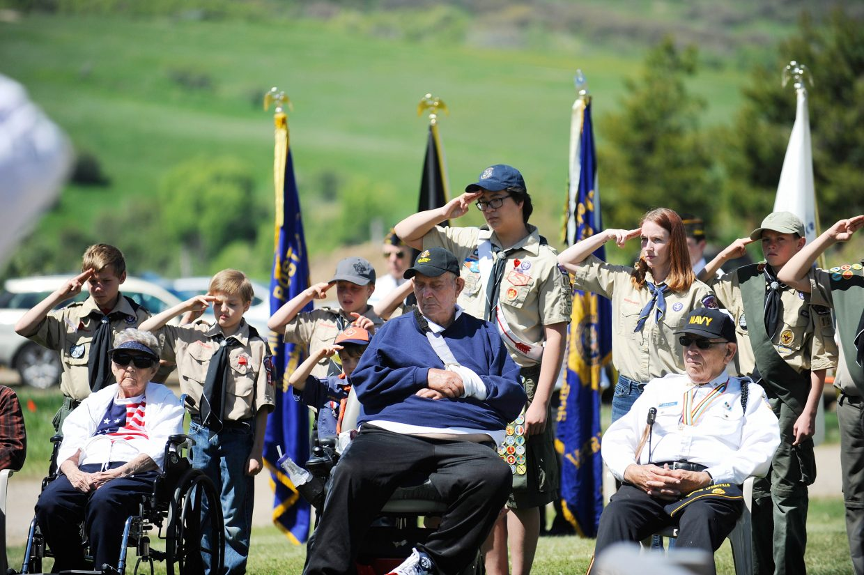 Boy Scouts salute during Monday's Memorial Day ceremony at the Steamboat Springs Cemetery.