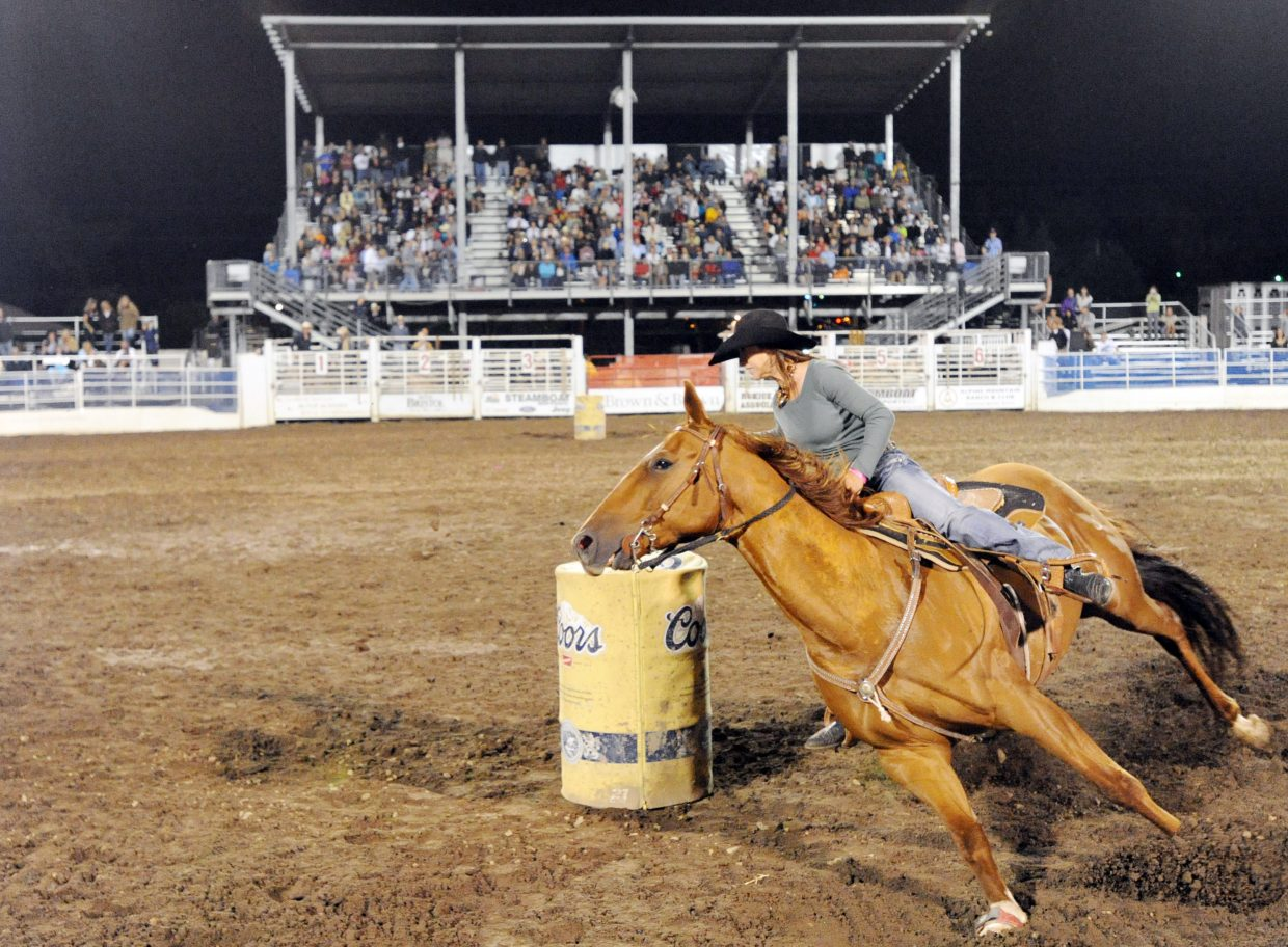around a barrel Saturday night as she rode to wrap up her fourth season-long barrel racing championship at the final Steamboat Springs Pro Rodeo performance of the season.