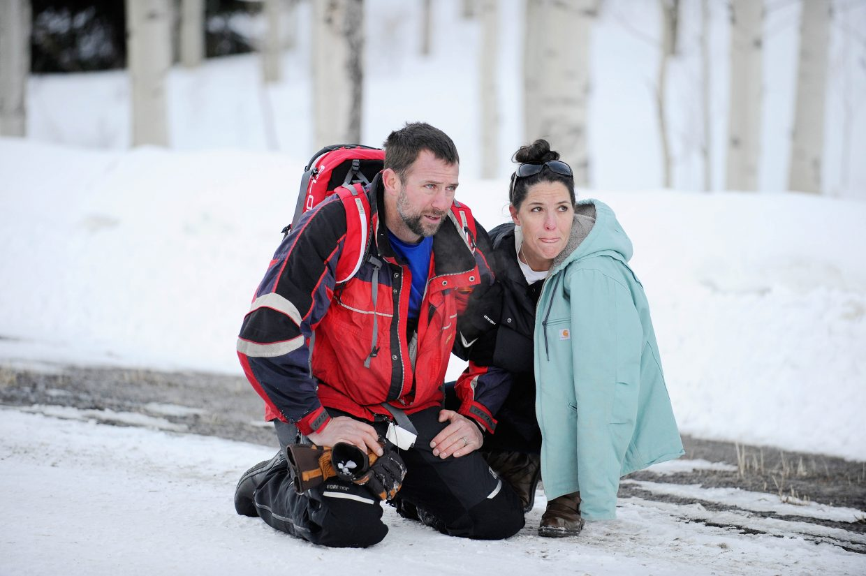 Franktown resident Sean Searle is reunited with his wife, Staci, after Searle was rescued from an avalanche Tuesday in the Flat Tops Wilderness. A Routt County man died in the slide.