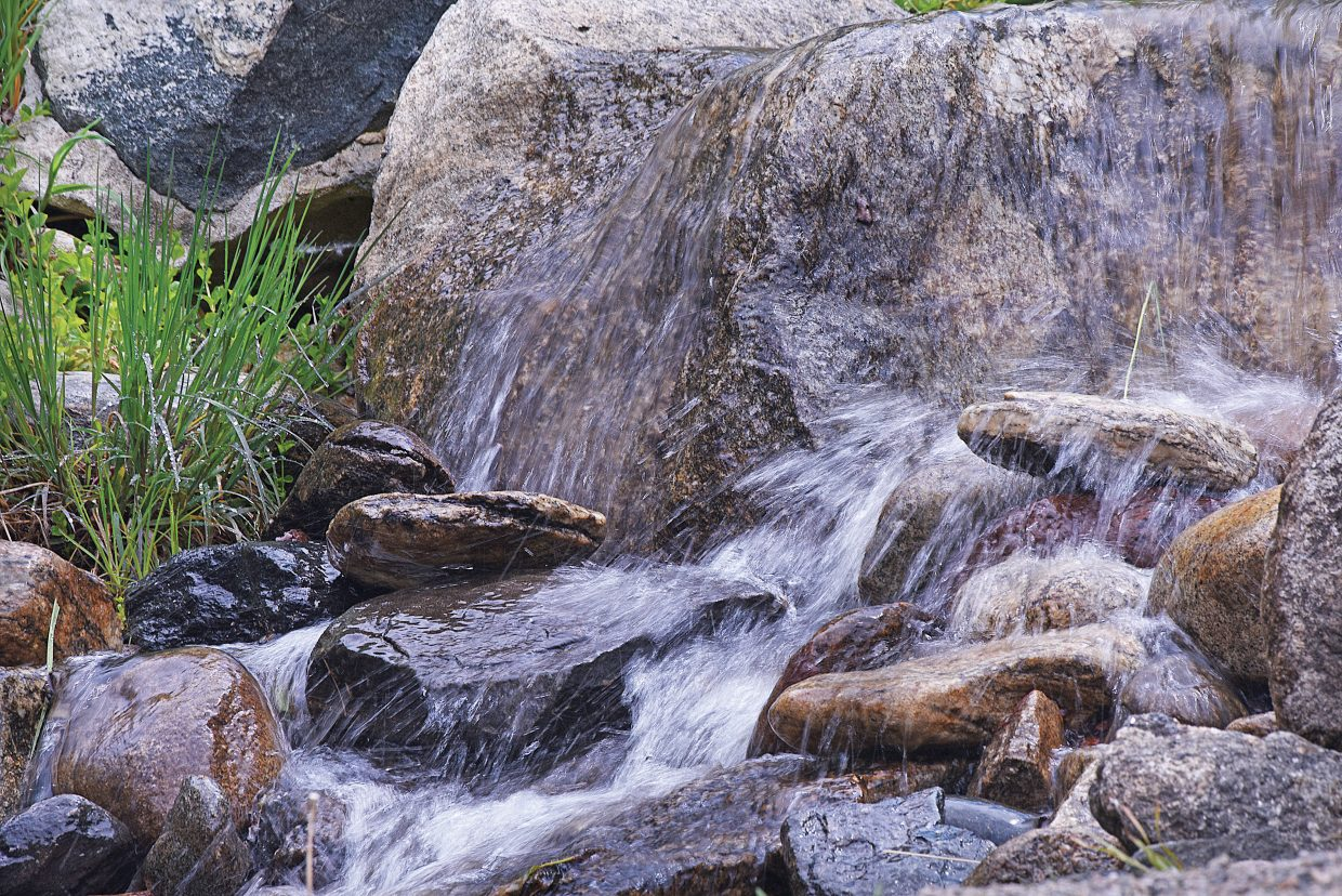 Water rolls over the rocks near a pond at the Yampa River Botanic Park in Steamboat Springs.