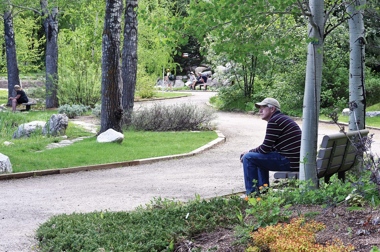 Chris Hubbell enjoys a quiet moment and a nice view while visiting the  Yampa River Botanic Park Thursday afternoon.