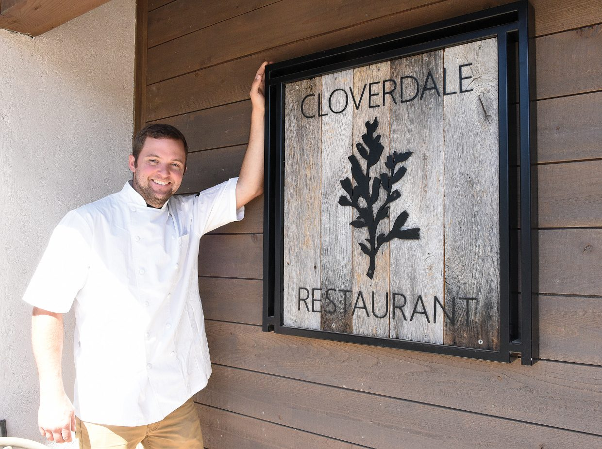 Patrick Ayres, who grew up in Steamboat Springs, reluctantly poses outside the new Cloverdale Restaurant he owns. Ayres said he was a little uncomfortable posing for the photograph since turning the historic downtown home into a restaurant featuring many locally grown food items has been a team effort.