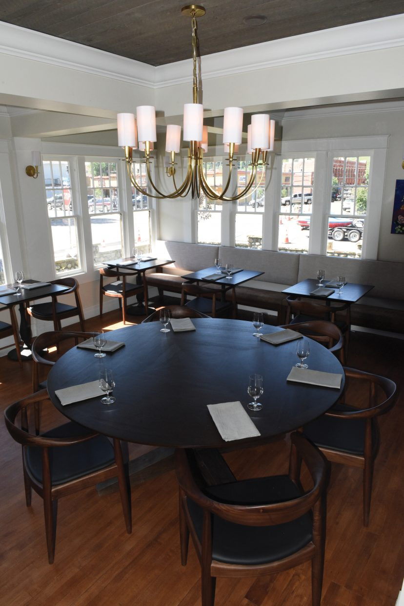 The main dinning room features high ceilings and the home's original hardwood floors.
