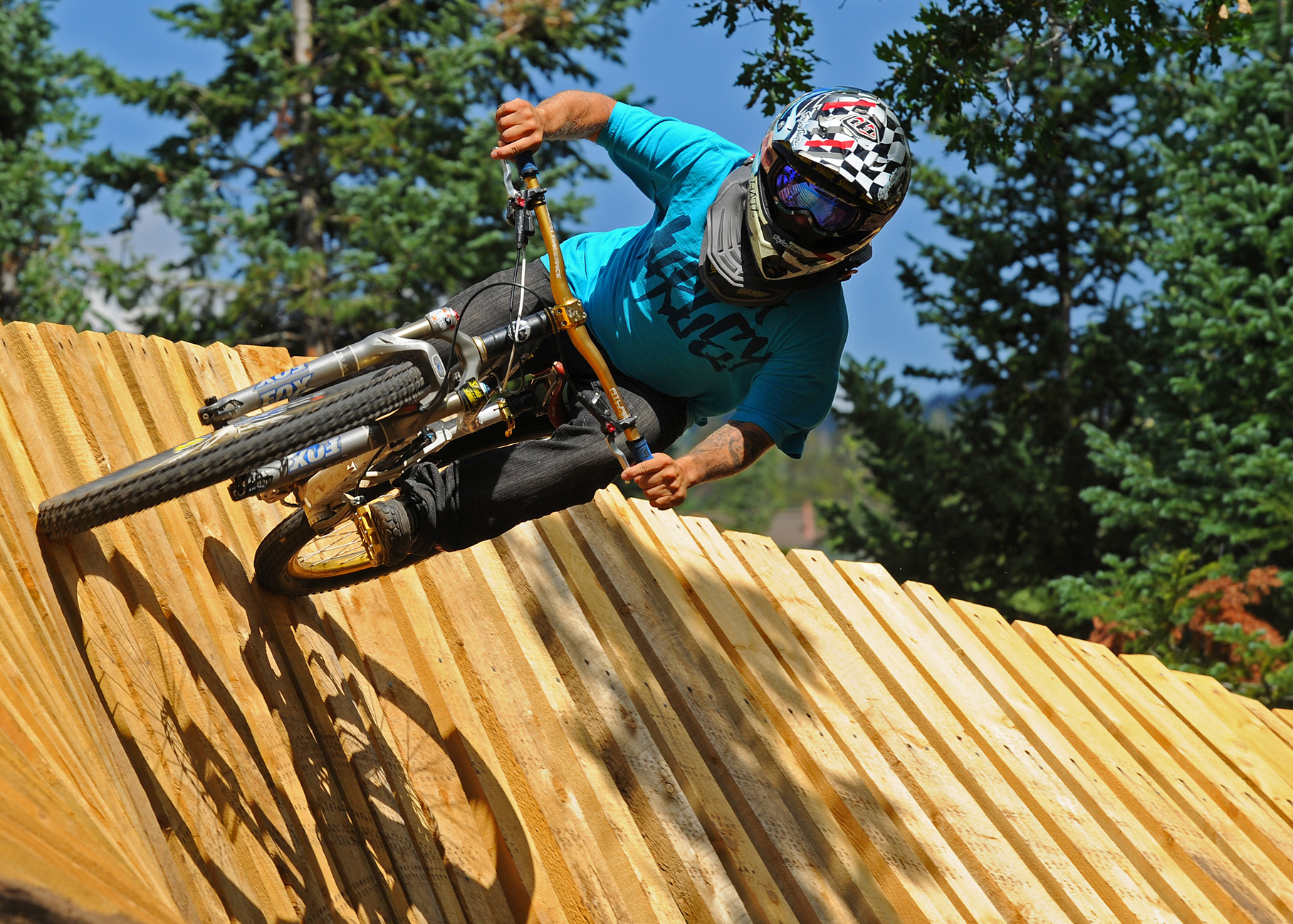 f313f76c7e5 Cory Prager flies around a turn at the Steamboat Bike Park at the ski area.  The park's upper mountain trails will be closed for the duration of the  summer ...