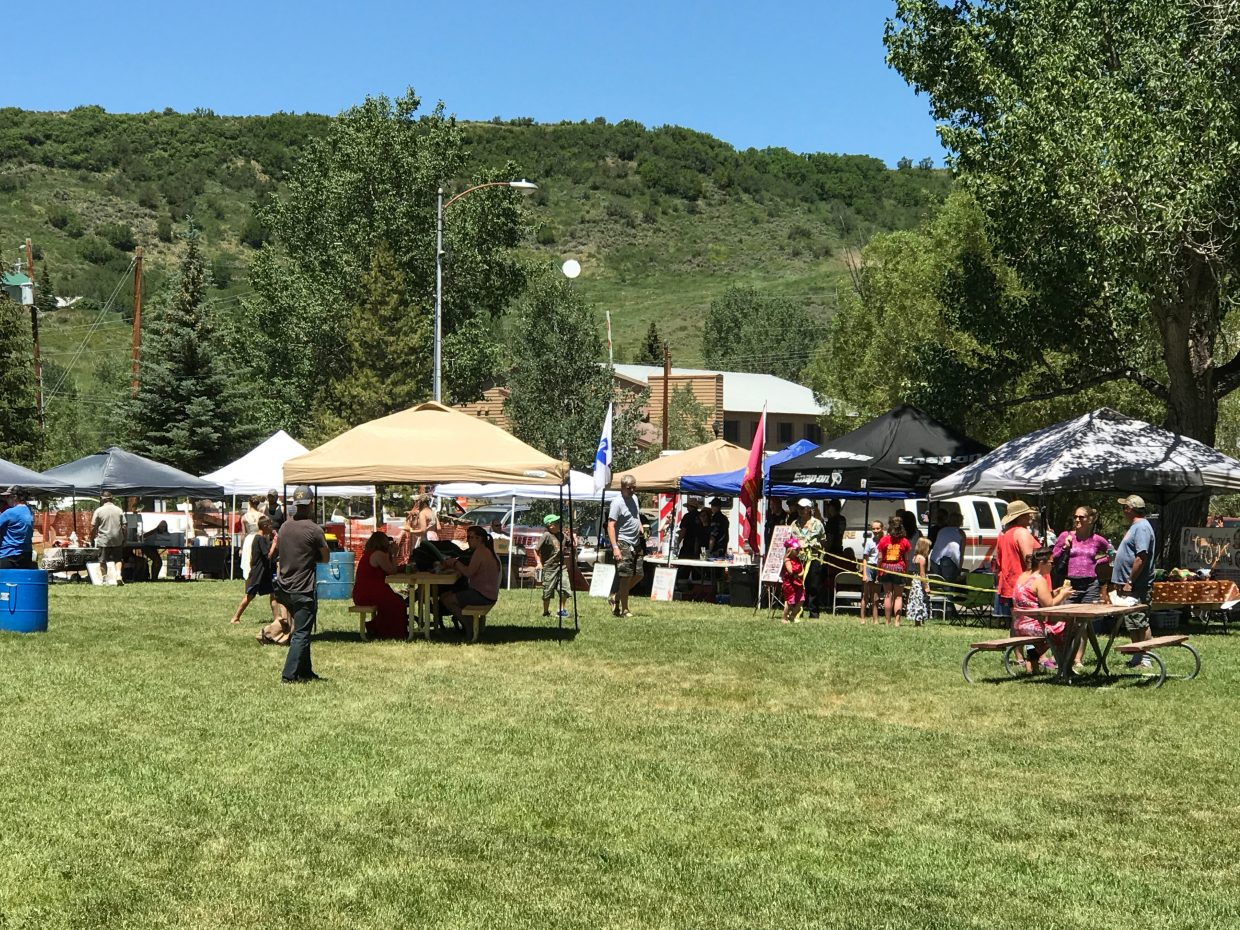 Attendees at Taste of South Routt make their way among the booths on display Saturday in Oak Creek's Decker Park.
