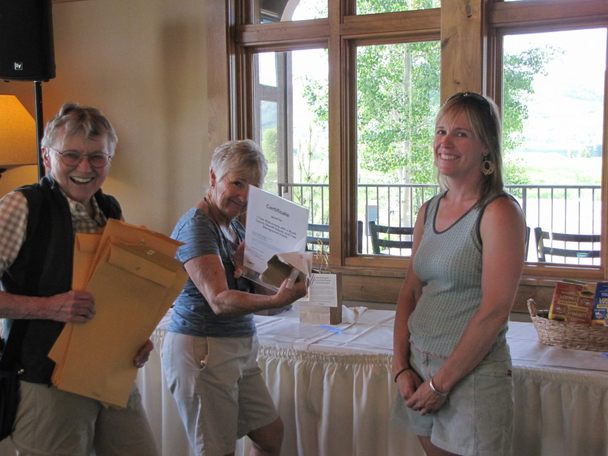 Karen Pharris, Natelie Sattler and Charlotte Jensen, all volunteers on the committee helping to set up for the event.