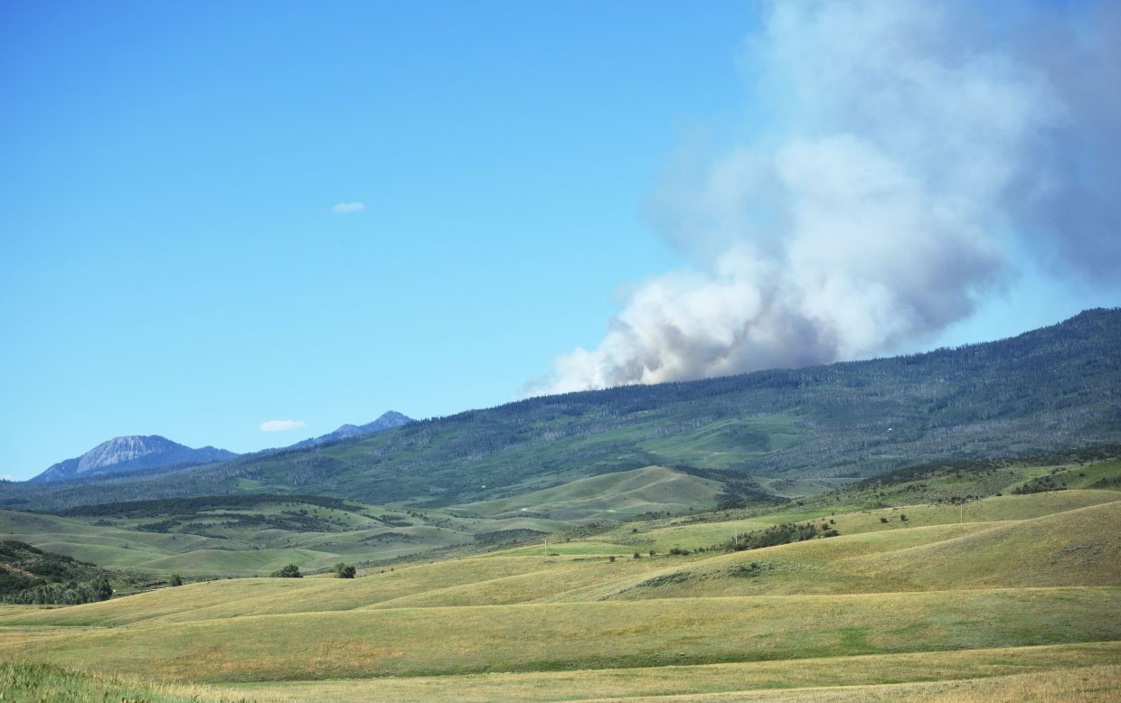 The Mill Creek Fire burns with Sand Mountain and Hahn's Peak in the background Saturday.