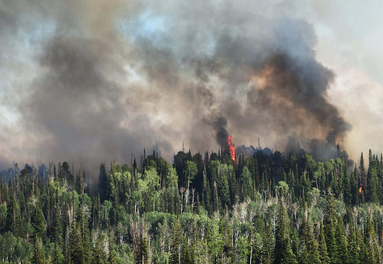 The Mill Creek fire flares up Saturday in North Routt County.