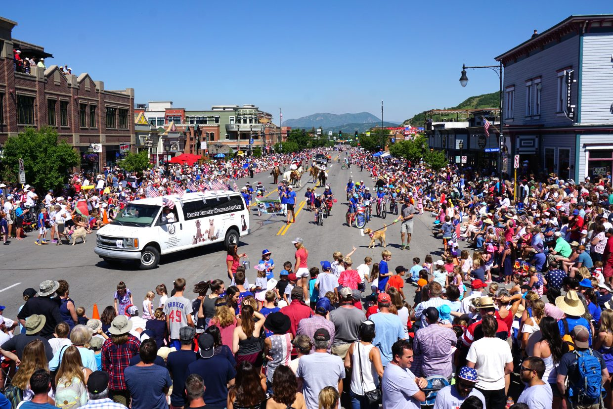 The Routt County Humane Society van drives on Lincoln Avenue during the Fourth of July parade.