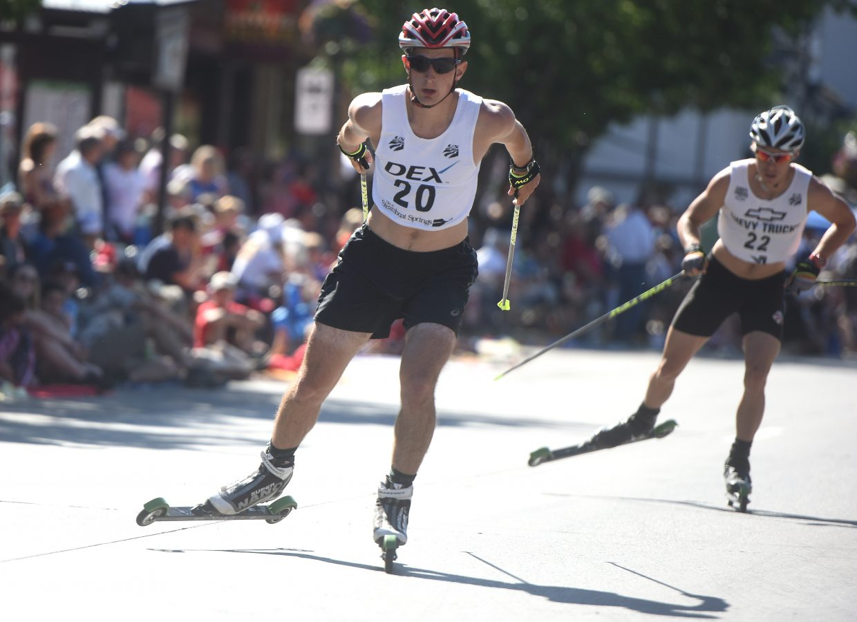 Grant Andrews flies down Lincoln Avenue on Tuesday during the Fourth of July Nordic combined event in Steamboat Springs.