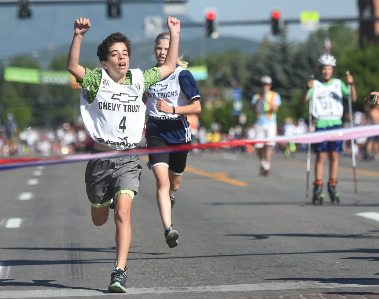 Zach Selzman crosses the finish line during the 1-kilometer Nordic combined running race on Tuesday in Steamboat Springs.