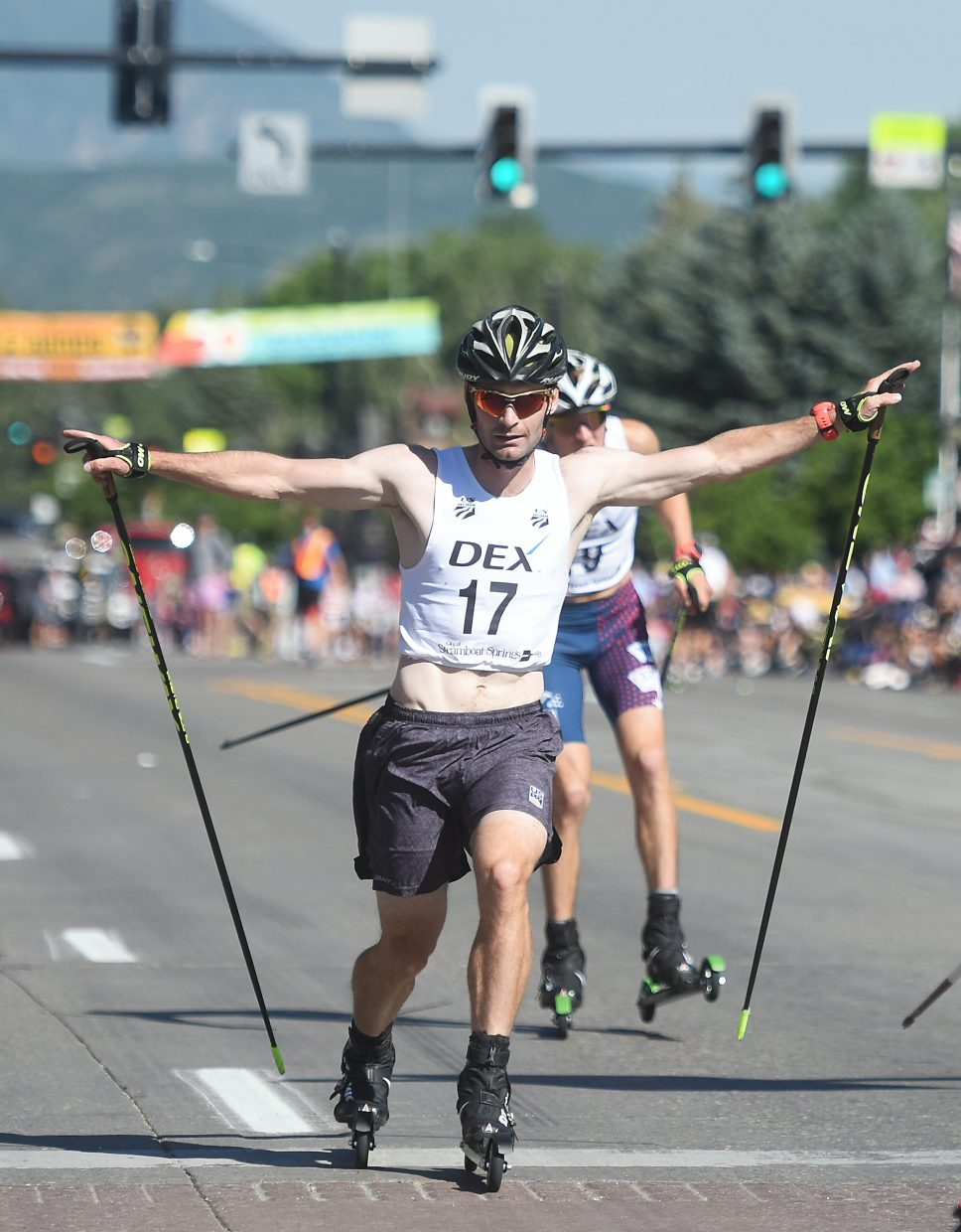 Bryan Fletcher throws his arms wide as he crosses the finish line in first place during the annual Fourth of July Nordic combined event in Steamboat Springs. On Sunday in Lake Placid, New York, Fletcher won his third Nordic combined national championship.