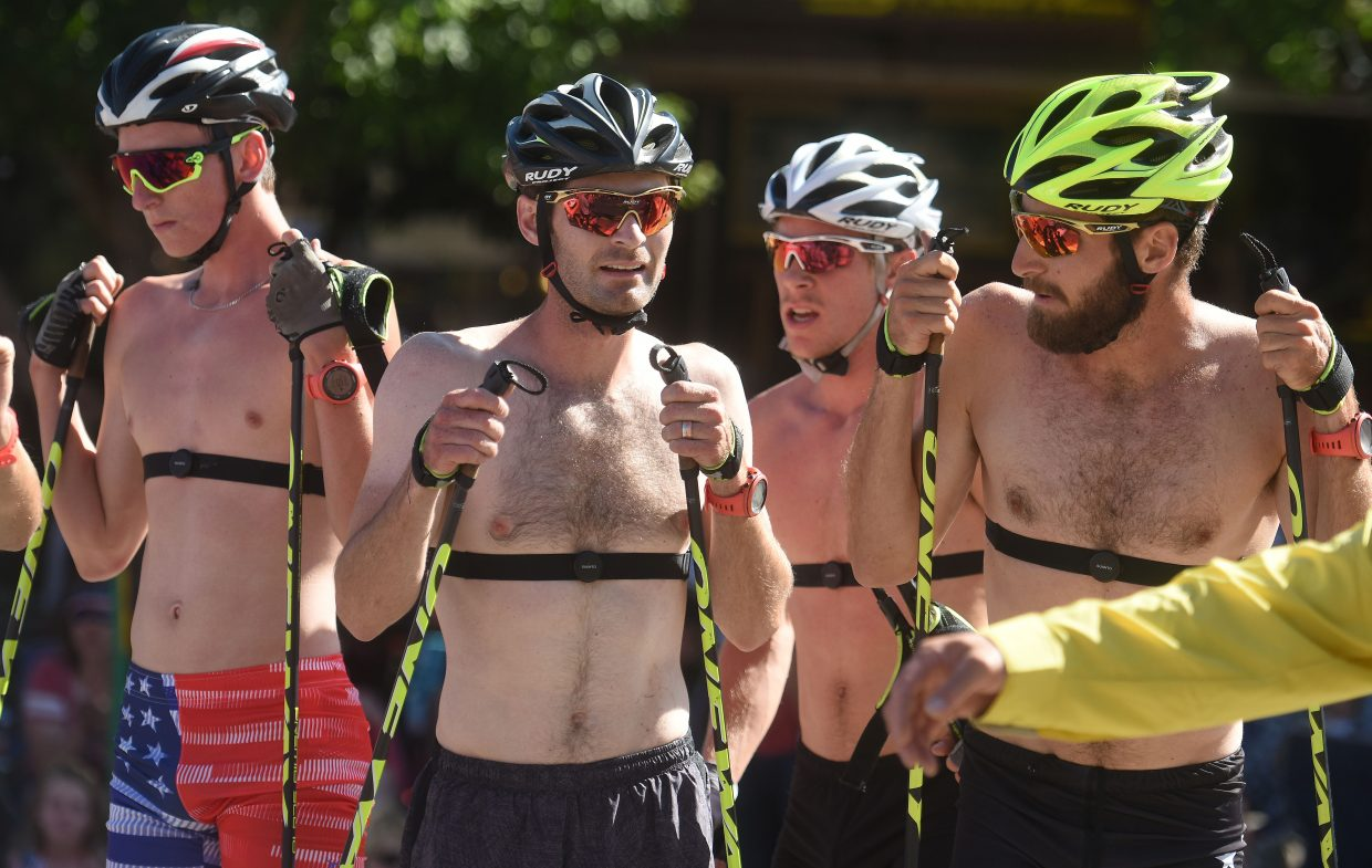 Members of the U.S. Nordic Combined Ski Team catch their breath after Tuesday's Fourth of July Nordic combined race in downtown Steamboat Springs.