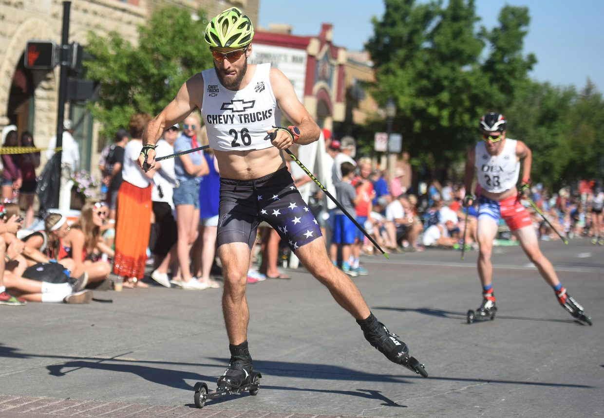 Taylor Fletcher works his way up the street Tuesday during the Fourth of July Nordic combined event in Steamboat Springs.