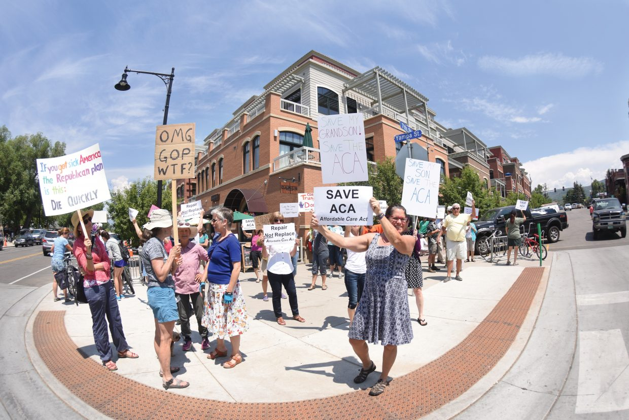 A large crowd of residents from Routt County came out Friday hoping to express their feelings on health care with Senator Cory Gardner at Carl's Tavern in downtown Steamboat Springs. Gardner cancelled the lunch missing a chance to meet with local Republican leaders and he also missed the crowd outside.