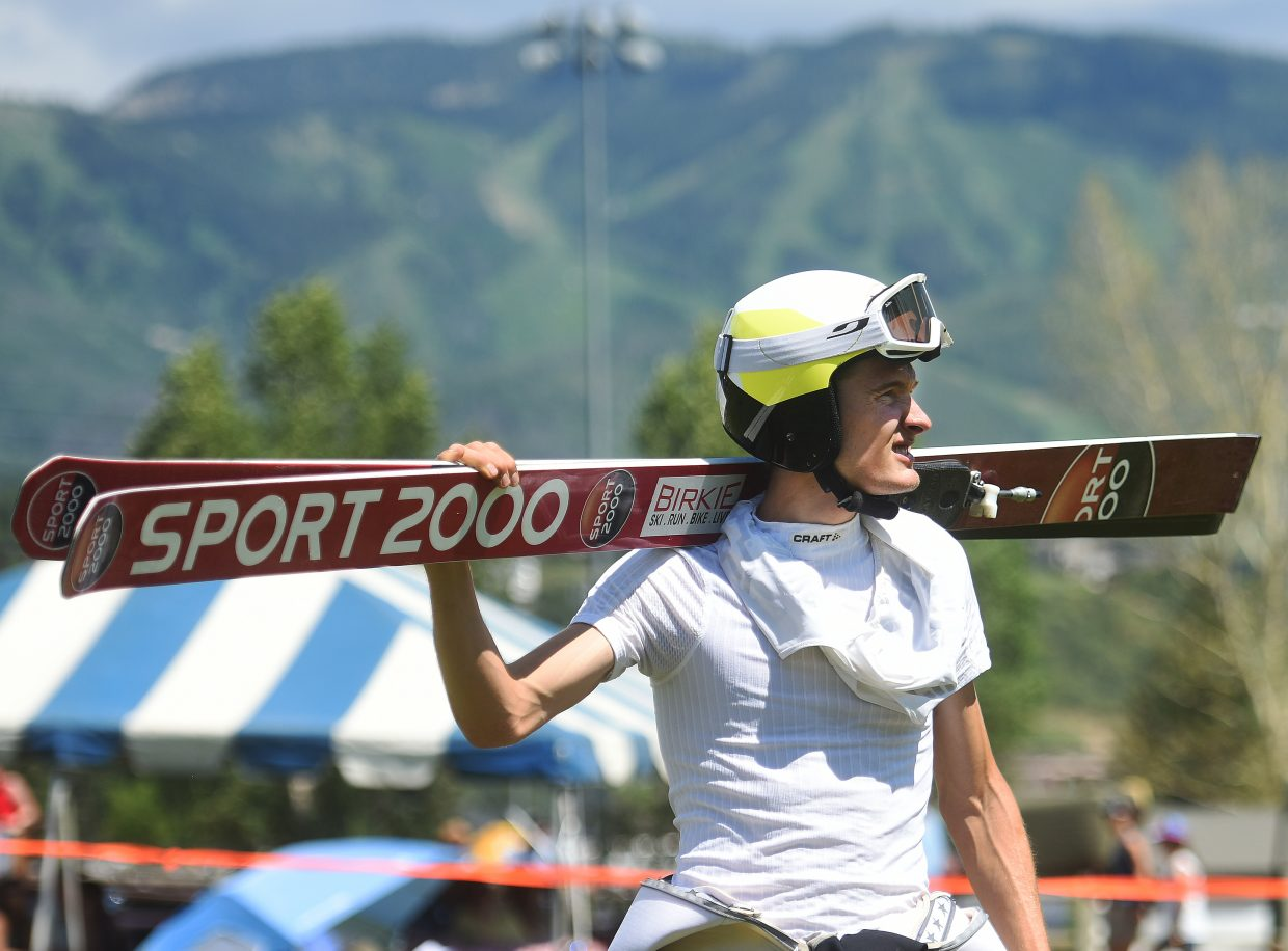 Adam Loomis looks on after his final jump at the Fourth of July ski jumping competition.