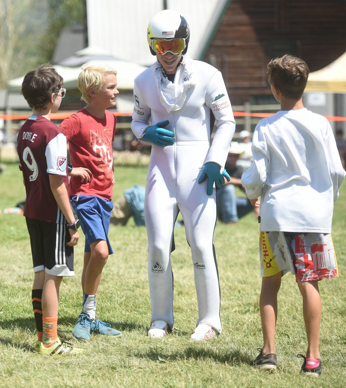 Ben Berend is surrounded by young ski jumpers during the Fourth of July ski jumping competition in Steamboat Springs.