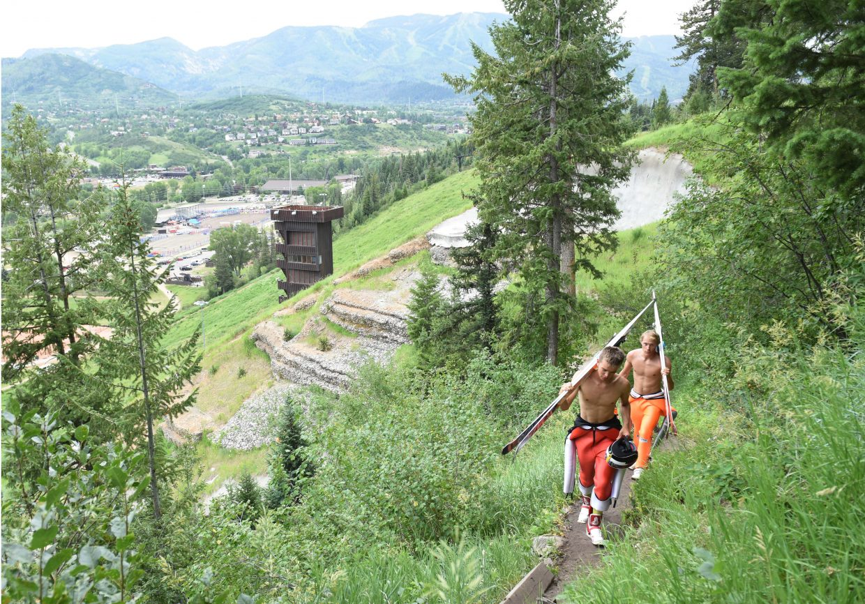 Jasper Good, front, and Ben Berend hike toward the HS75 ski jump on Howelsen Hill in Steamboat Springs.