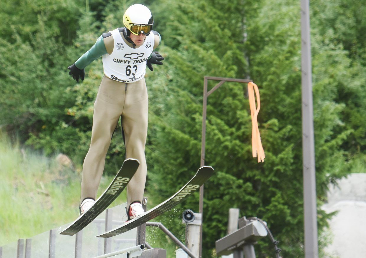 Grant Andrews leaps off the end of the HS75 ski jump in Steamboat Springs.