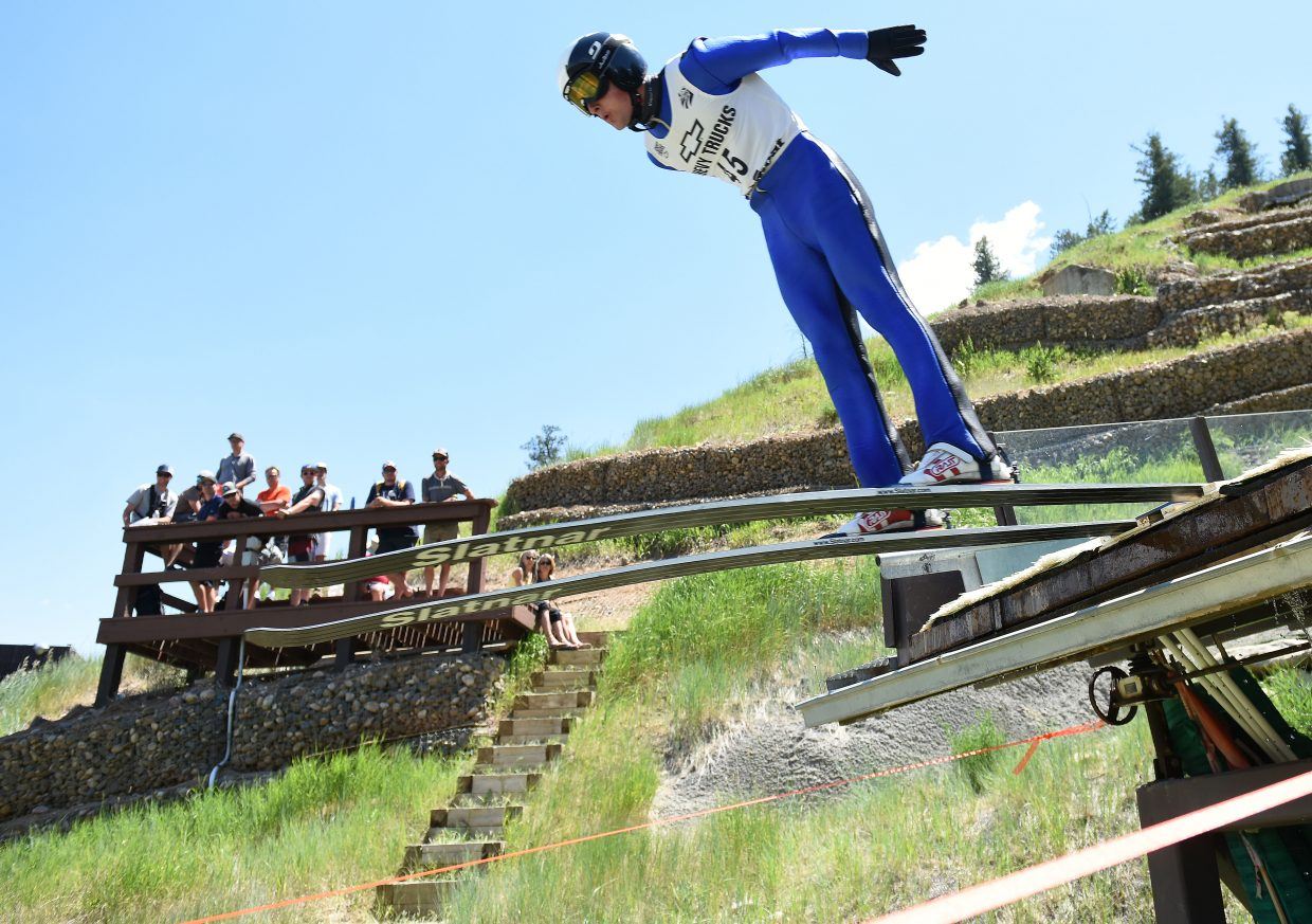 Grant Andrews ski jumps in Steamboat Springs.