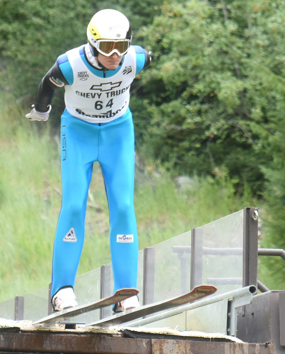 Adam Loomis hits the end of the HS75 ski jump in Steamboat Springs.
