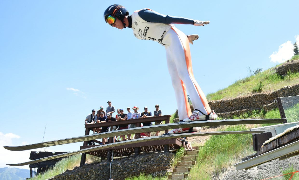 Stephen Schumann flies in front of his coaches during the Fourth of July ski jumping competition in Steamboat Springs.
