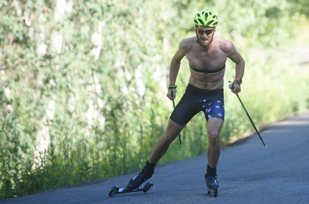 Taylor Fletcher flies up Fish Creek Falls road during a time trial roller ski event in Steamboat Springs.
