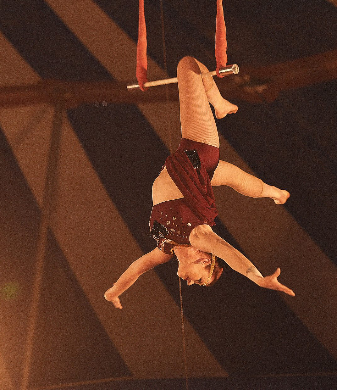 Performer Simone Key entertains the crows on the trapeze during a performance at the Culpepper & Merriweather Circus Tuesday afternoon at the Brent Romick Rodeo Arena. The circus stopped in Steamboat Springs for performances Monday and Tuesday.