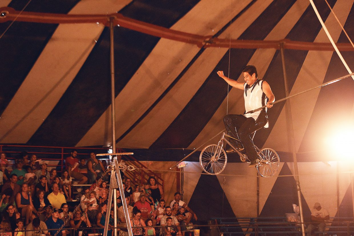 Romario Perez entertains the crowd on the tight wire during a performance at the Culpepper & Merriweather Circus Tuesday afternoon at the Brent Romick Rodeo Arena. The circus stopped in Steamboat Springs for performances Monday and Tuesday.