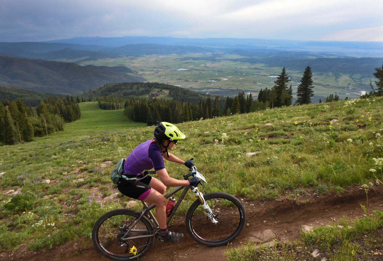 Alisha Johnansson pedals Wednesday in the Bike Town Challenge hill climb at Steamboat Ski Area.
