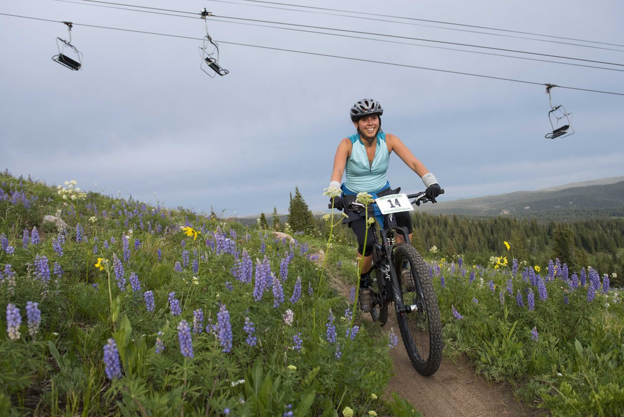 Kyleigh Lawler pedals under the Sundown Express chairlift near the top of Steamboat Ski Area on Wednesday for the Bike Town Challenge, a hill climb race to the top of Storm Peak as a part of the Town Challenge mountain bike race series.