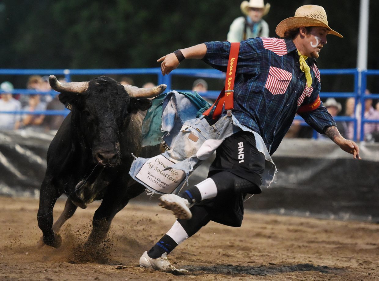 Connor Rowley stays a step ahead of his bull Wednesday at Bulls and Bands in downtown Steamboat Springs.