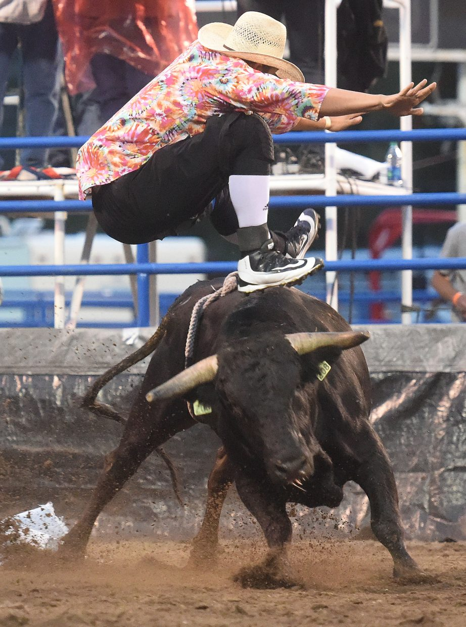 A bull fighter gets vertical to avoid his bull Wednesday in Steamboat Springs.