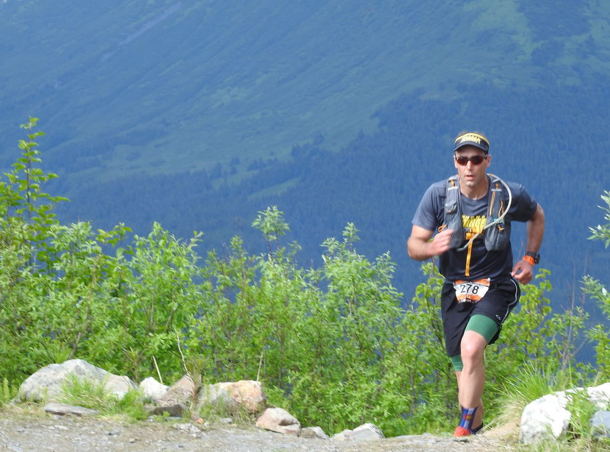 TJ Thrasher makes his way up Mount Alyeska during the Alaskaman Extreme Triathlon.