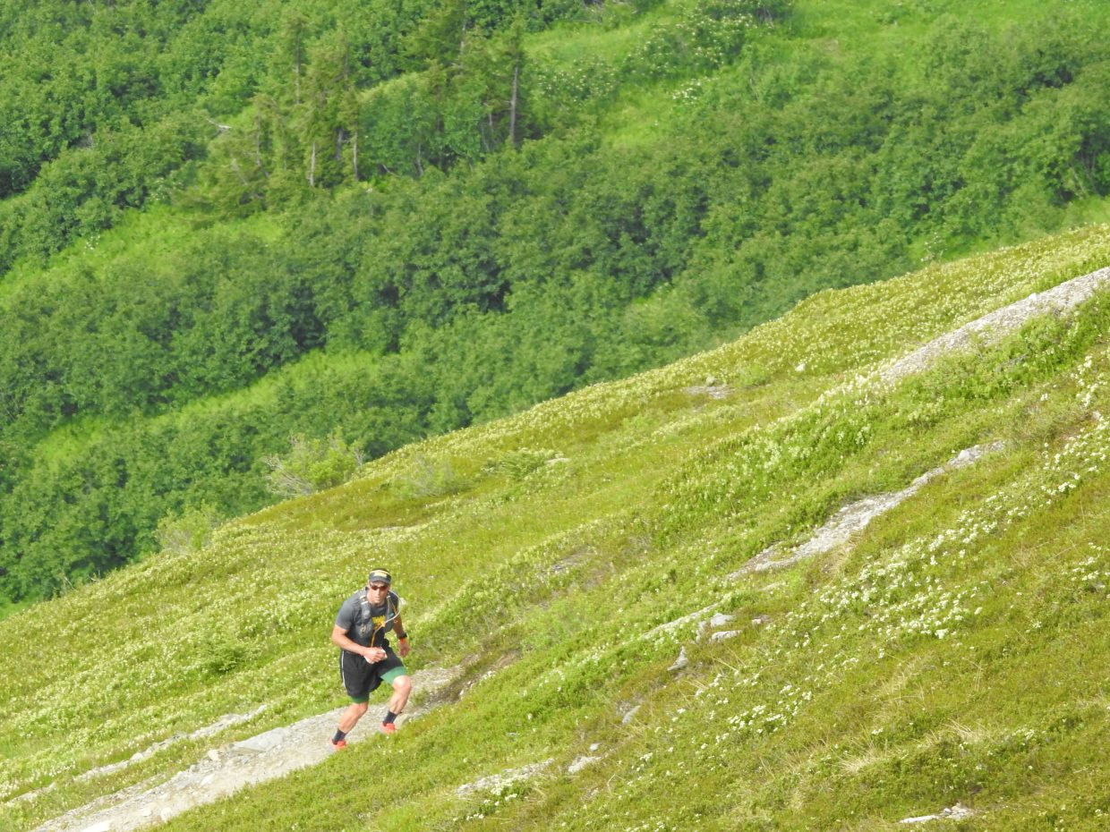 TJ Thrasher climbs Mount Alyeska during the Alaskaman Extreme Triathlon.