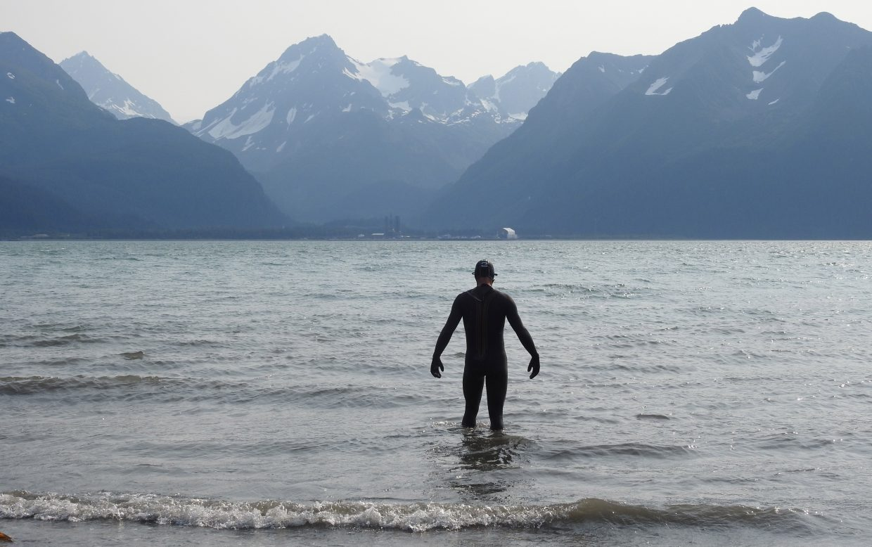 TJ Thrasher looks out on the frigid course for the swim section of the Alaskaman Extreme Triathlon.