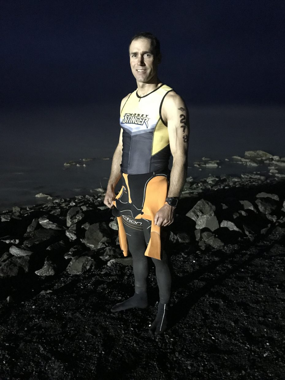 TJ Thrasher poses before the swim start of the Alaskaman Extreme Triathlon.