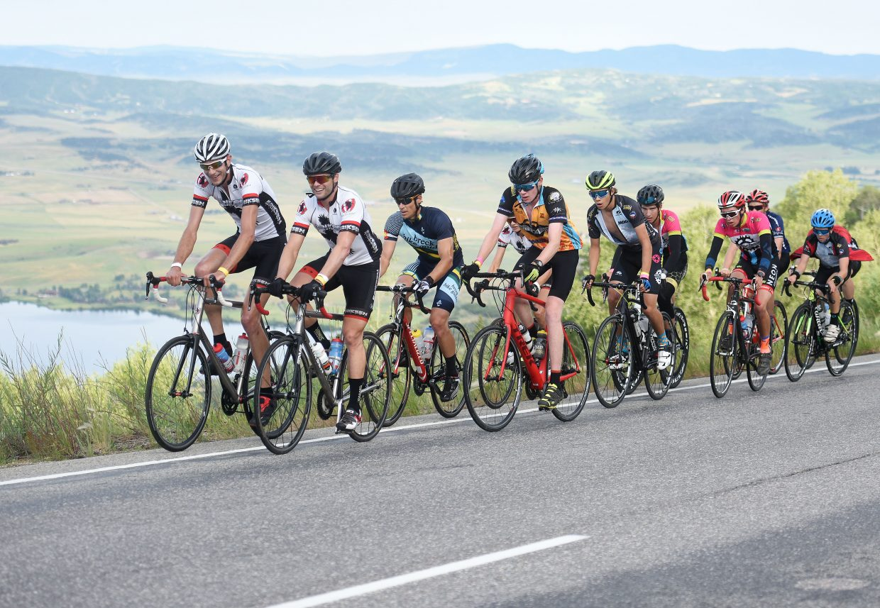 Brad Bingham, second, helps lead a big pack of cyclists up Rabbit Ears Pass early during Saturday's Tour de Steamboat.