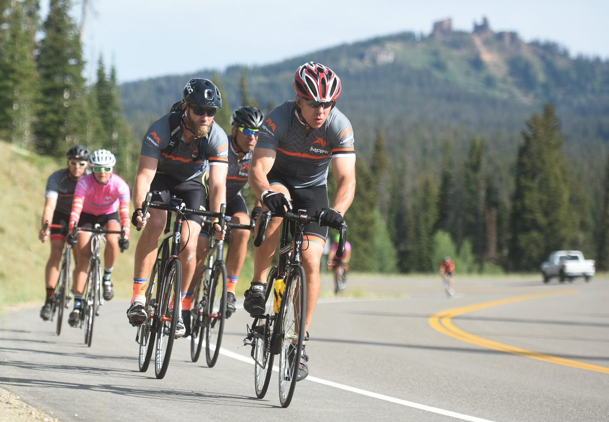 Riders from Manic Training fly along U.S. Highway 40 during Saturday's Tour de Steamboat.