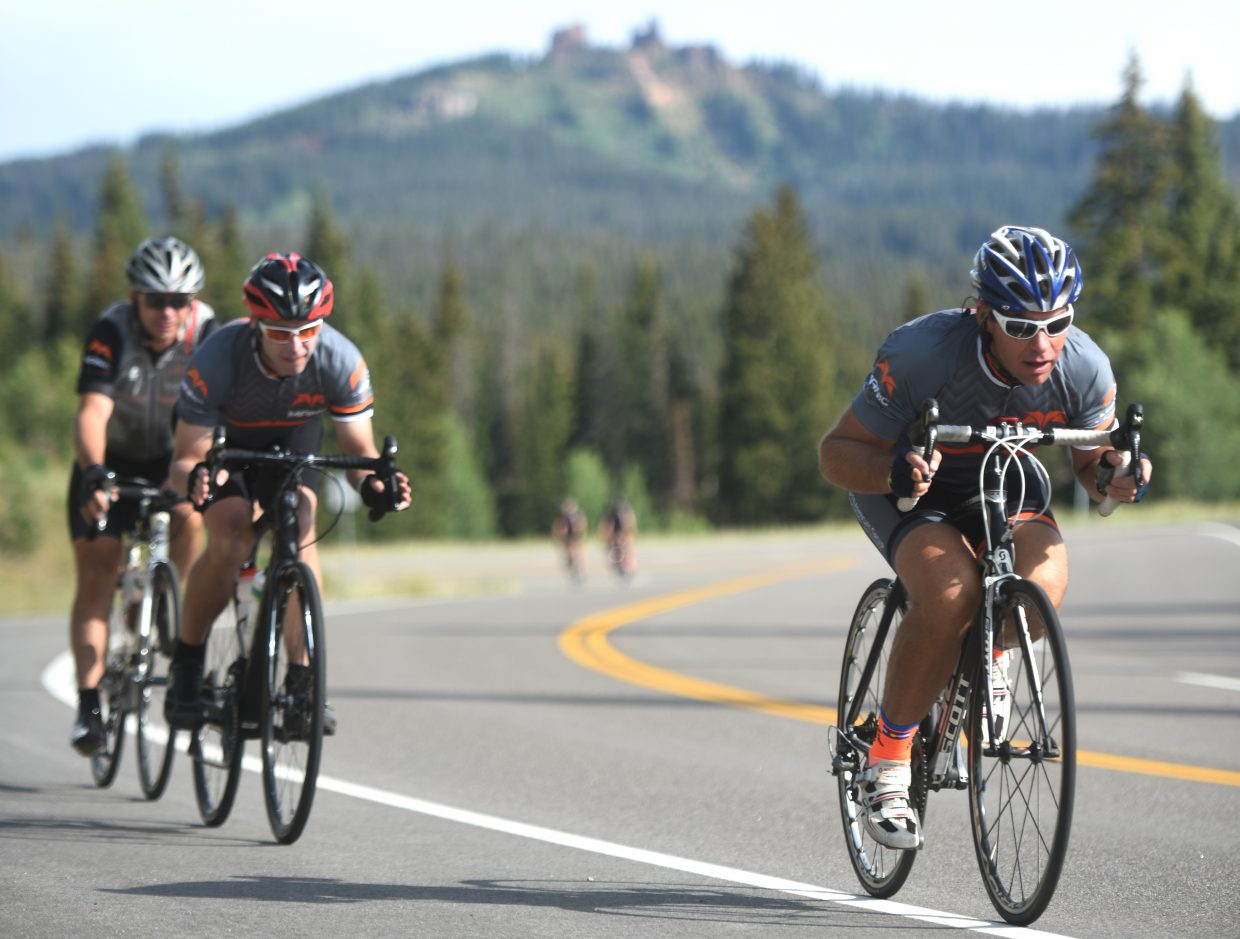 Riders duck low as they speed down from Rabbit Ears Pass on Saturday during the Tour de Steamboat.