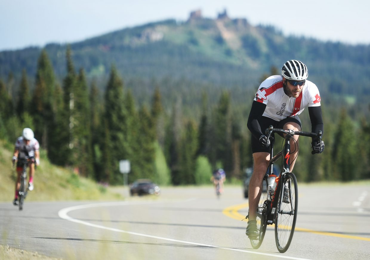 A cyclist gets out of the saddle Saturday during Tour de Steamboat.