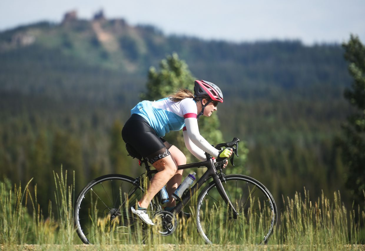 A rider zips under Rabbit Ears Peak on Saturday during Tour de Steamboat.