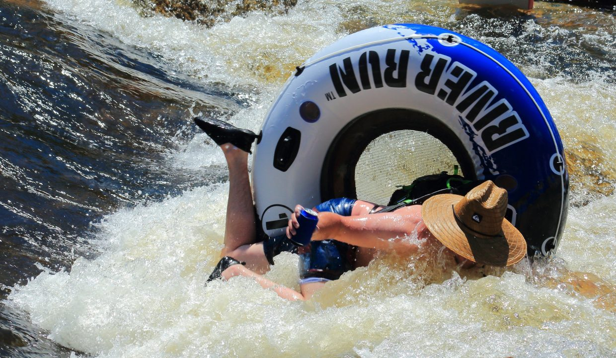 I was out taking pictures along the Yampa and shot this. This little river rat rode the wave out and showed up all the big kids. In the hole by the library. You can have the full files if you want them.