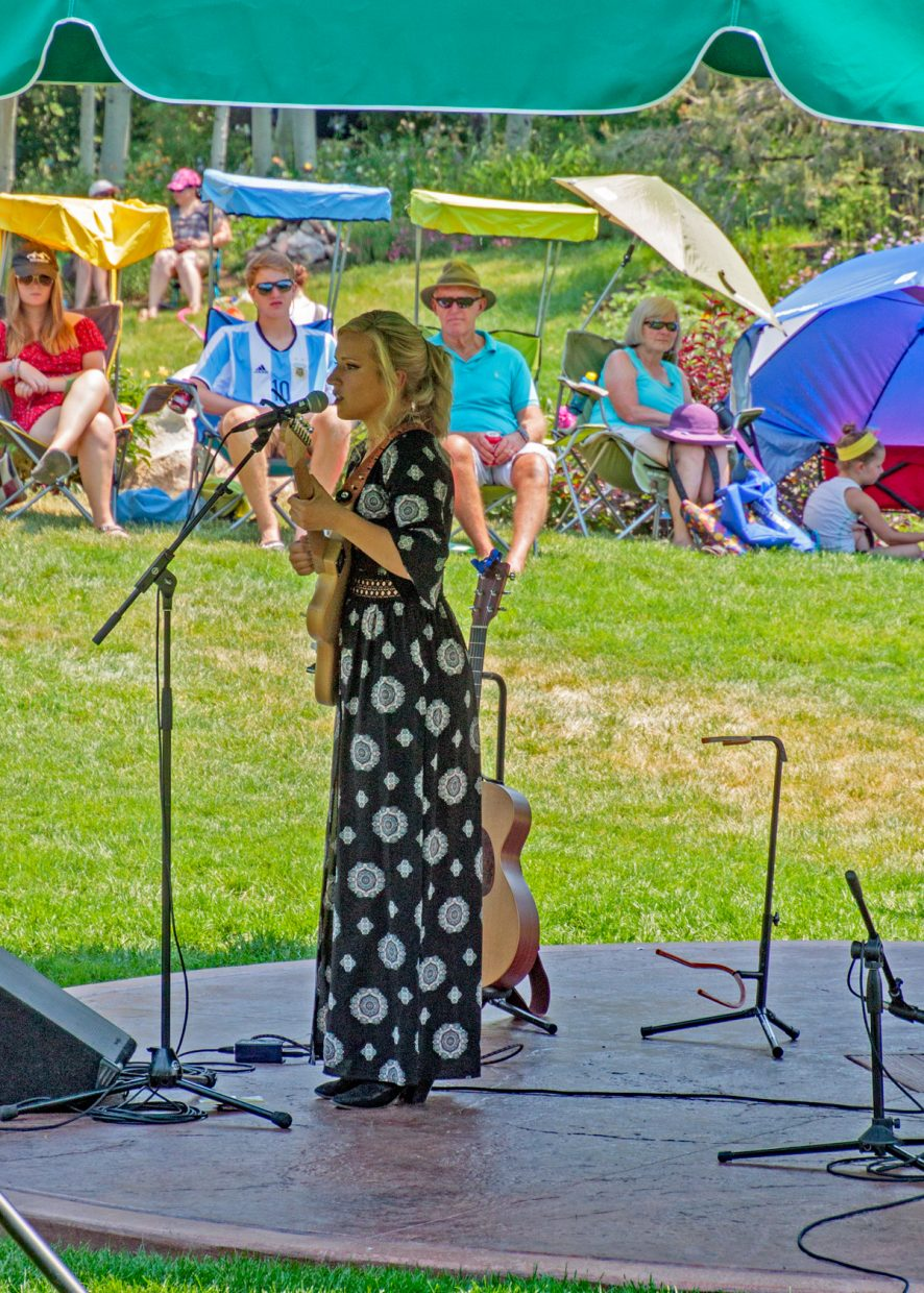 Singer, songwriter Kelly Kerr entertains the crowd at Music on the Green.
