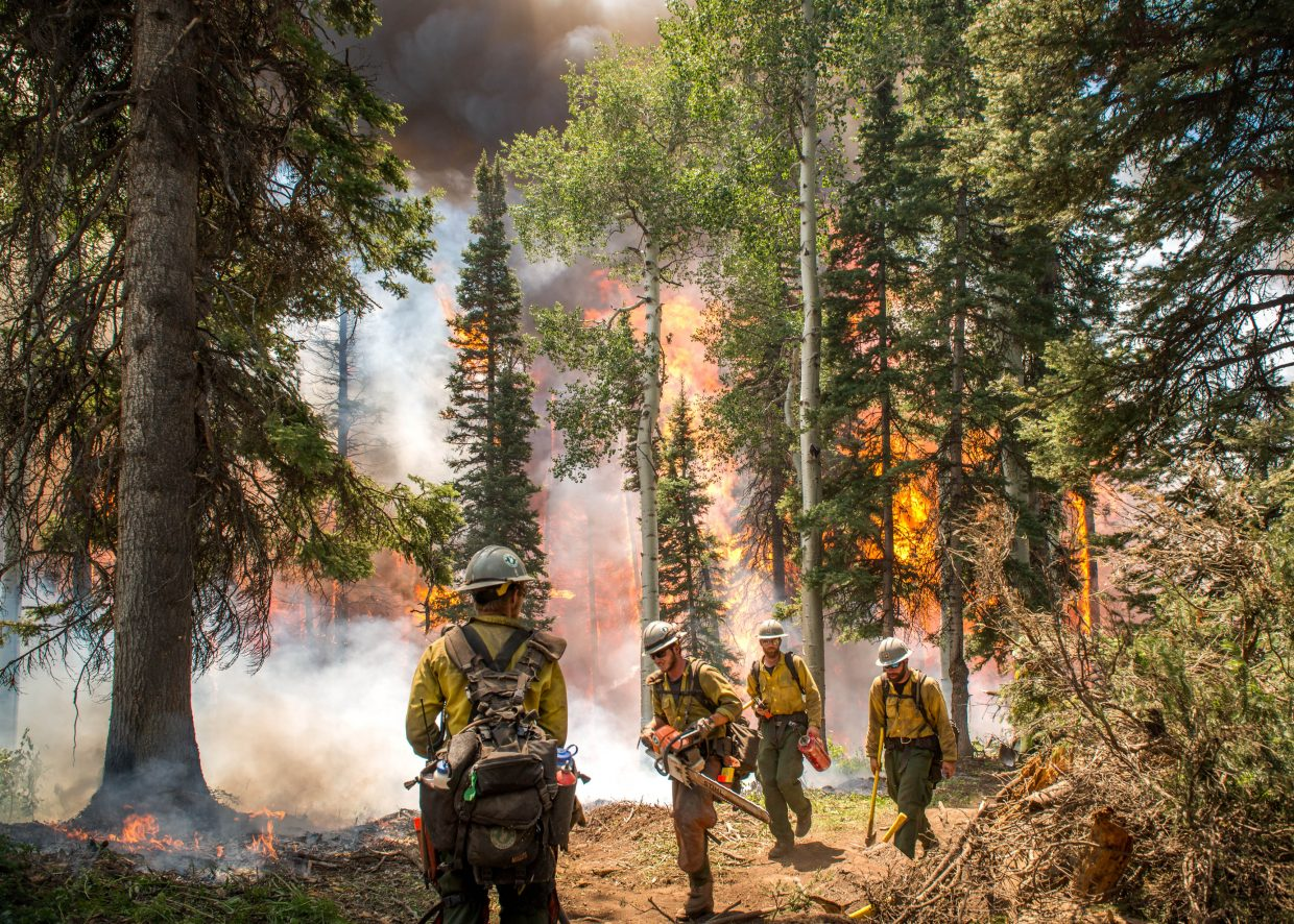 Firefighters work at the Mill Creek Fire.