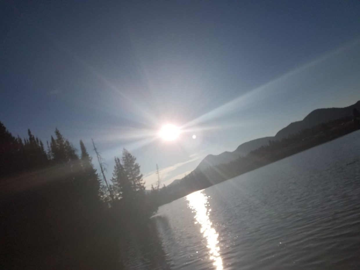 The sun glints off the surface of Steamboat Lake.