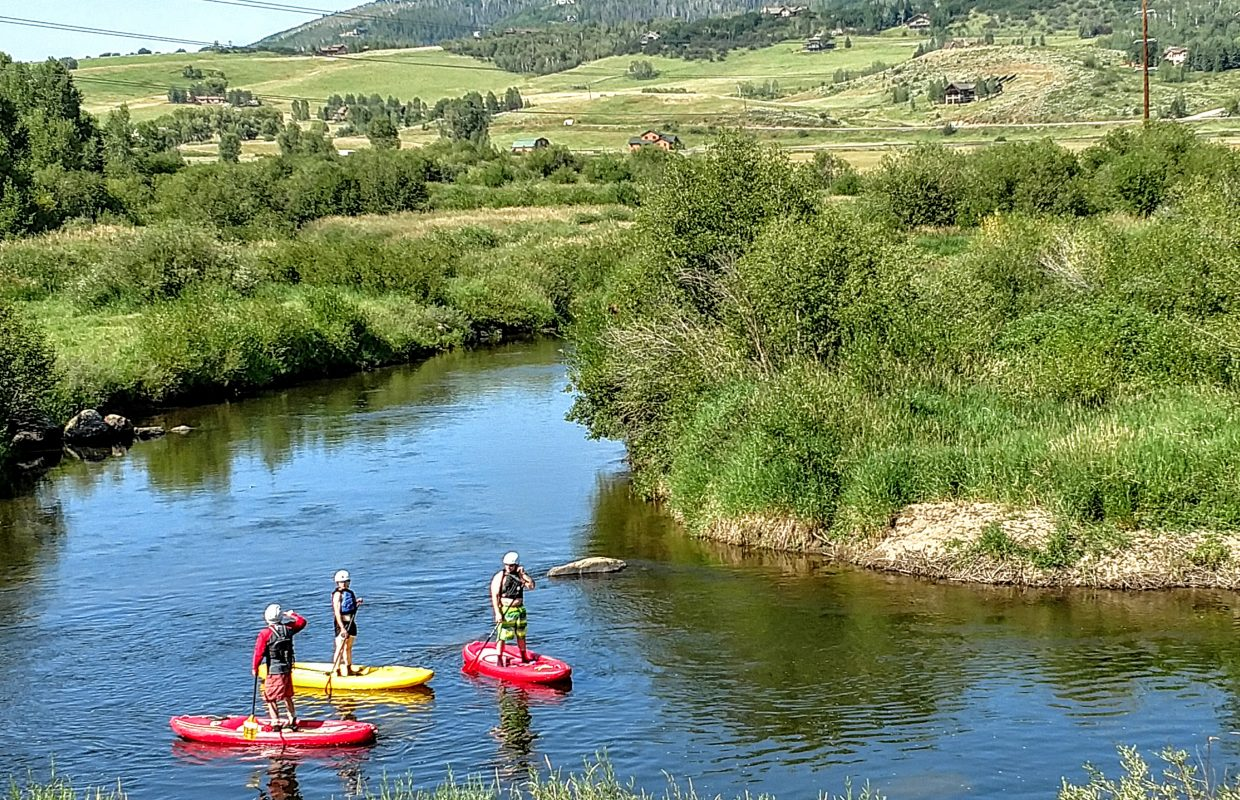 Paddleboarders on the Yampa.